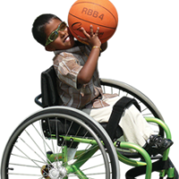 Child in wheelchair playing basketball