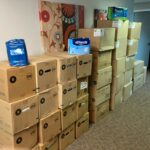 Image contains boxes of adult diapers that have been donated by a parent to AND