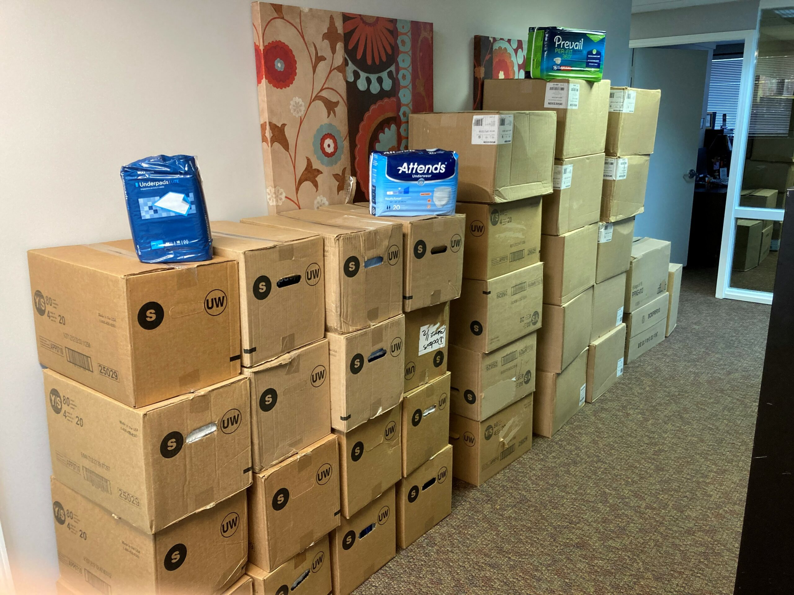 Image of boxes of adult diapers that have been donated by a parent to AND